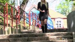 Blonde on Steps screen cap #2