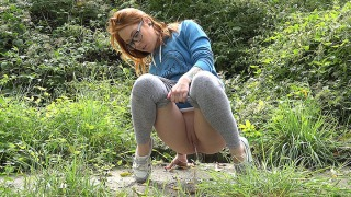 Pee Video Redhead in Glasses
