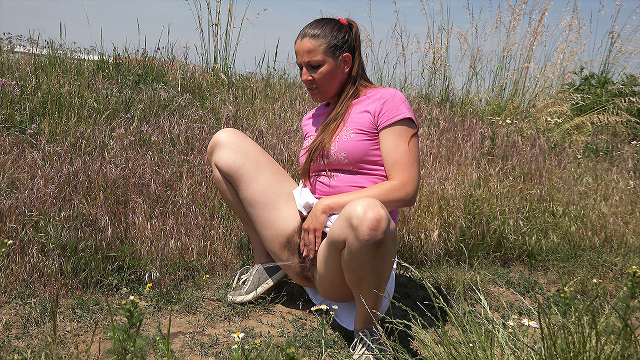 Squatting in the Long Grass